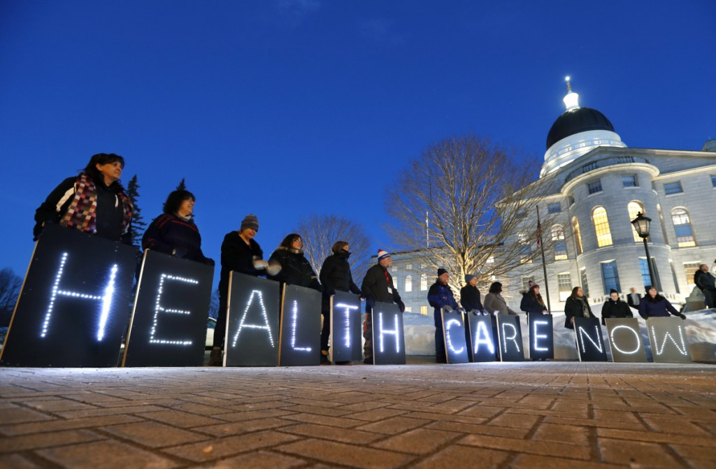 Medicaid expansion advocates rally in Augusta before Gov. Paul LePage's address to the state in February. The governor has opposed the expansion that was approved by vorers.
