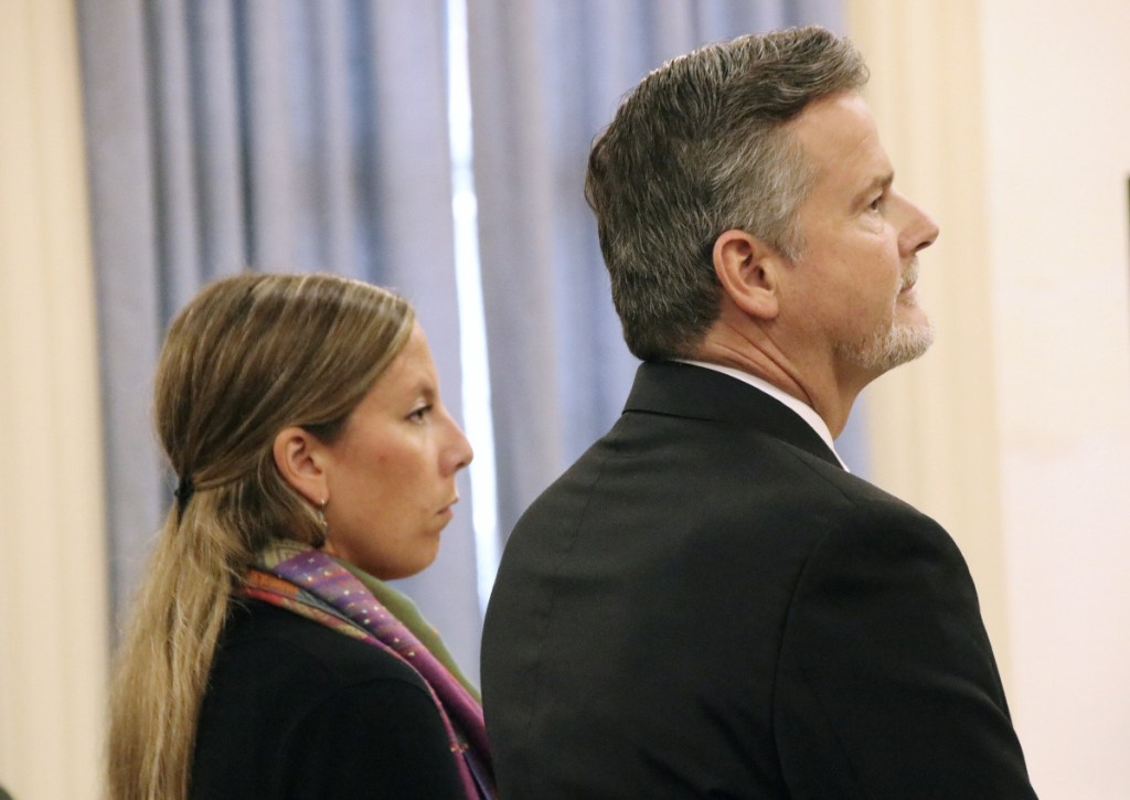 Jill Lamontagne, 30, with her attorney Scott Gardner, on the first day of her trial Monday at York County Superior Court in Alfred.
