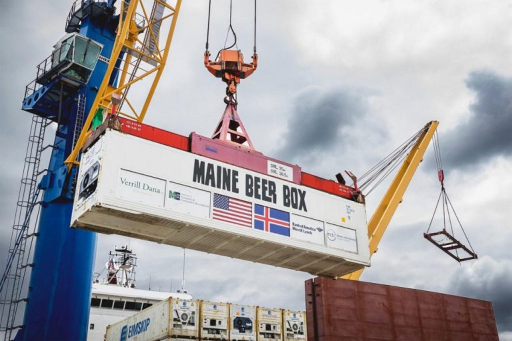 The Maine Beer Box being hoisted by a crane at the International Marine Terminal in Portland onto an Eimskip ship before sailing to Reykjavik in June 2017.