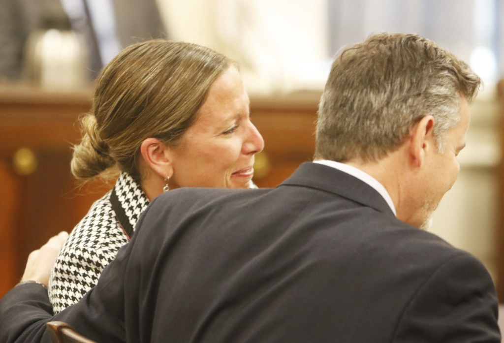 Jill Lamontagne, seated with her attorney, Scott Gardner, reacts as a jury finds her not guilty at York County Superior Court in Alfred on Thursday.
