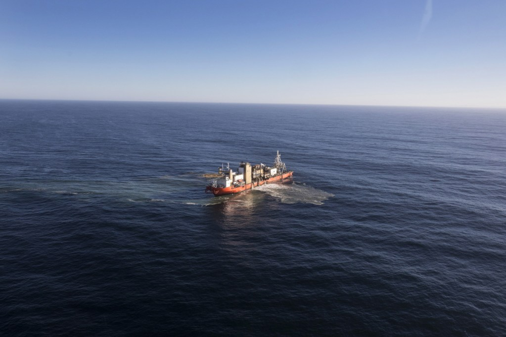 "The Mafuta diamond mining vessel operated by  searches for diamonds using a ""crawler"" tractor to suck up sediment from the seabed during operations in the Atlantic Ocean off the coast of Namibia in 2017."