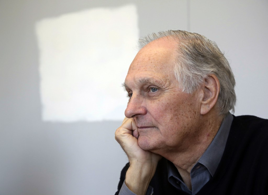 """Actor Alan Alda listens during an interview at Stony Brook University, on New York's Long Island in 2013.  Alda, appearing on """"CBS This Morning,"""" said he was diagnosed with Parkinson's disease three and a half years ago."""