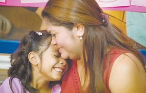 ALLISON, 6, and her mother Cindy Madrid share a moment during a news conference in Houston on July 13, where the mother and daughter spoke about the month and one day they were separated under the President Donald Trump administration immigration policy. MARIE D. DE JES'S / HOUSTON CHRONICLE VIA AP