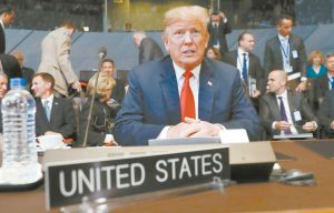 U.S. PRESIDENT Donald Trump takes his seat as he attends the multilateral meeting of the North Atlantic Council, Wednesday in Brussels, Belgium. AP POOL PHOTO / PABLO MARTINEZ MONSIVAIS