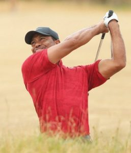 TIGER WOODS plays out of a bunker on the 10th hole during the final round for the 147th British Open Golf championships at Carnoustie, Scotland, on Sunday. THE ASSOCIATED PRESS