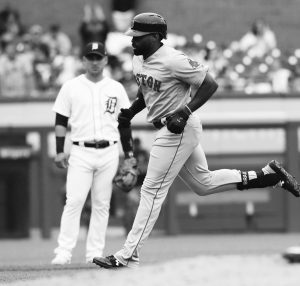 BOSTON'S JACKIE BRADLEY JR., trots around the bases after hitting a three-run home run in the fourth inning on Sunday. The Red Sox rolled to a 9-1 win over the Detroit Tigers. THE ASSOCIATED PRESS