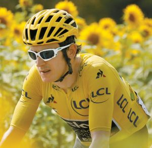 BRITAIN'S GERAINT THOMAS, wearing the overall leader's yellow jersey, passes fields of sunflowers during the eighteenth stage of the Tour de France cycling race over 171 kilometers (106.3 miles) with start in Trie-sur-Baise and finish in Pau, France, Thursday. THE ASSOCIATED PRESS