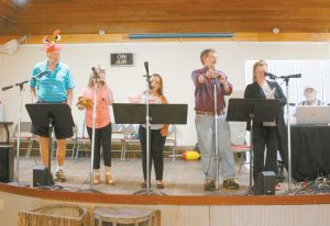 FROM LEFT, Leonard Marcotte, Autumn Bernier Siegel, Ava-Marie Cabral, Al Martorelli, Shirley Bernier and Ray Siegler at rehearsal for Harpswell Community Theater's annual summer show. The radio theater-style show features animal costumes and hand puppets. EMILY COHEN / THE TIMES RECORD