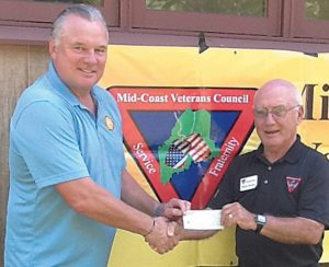 FORMER NFL KICKER MORTEN ANDERSEN, chairman of the Morten Andersen Family Foundation and a 2017 Football Hall of Fame inductee, has been a corporate sponsor for the Mid-Coast Veterans Council in Brunswick for the past four years. On a recent visit to Maine, Andersen, left, presented a $5,000 check to Read Rich, a director at the Resource Center. The center, located at 62 Pegasus St. in Brunswick Landing, supports and assists veterans and their familes in the Midcoast. For more information, call (207) 406-4103. PHOTO COURTESY OF MID-COAST VETERANS COUNCIL