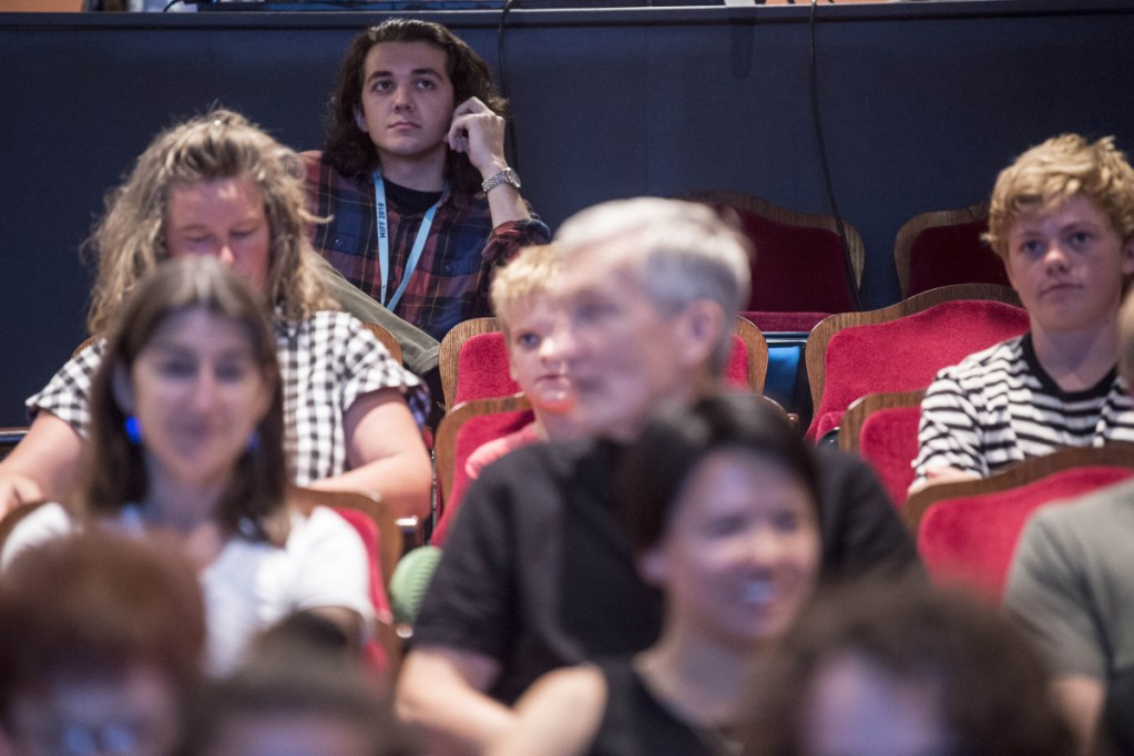 Noah LePage, director of the short film 'Elysia' sits in the back row of the Waterville Opera House before the screening of his new film during the Maine International Film Festival at the Waterville Opera House on Saturday.