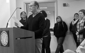 ROBERT JARRATT reads aloud to the Brunswick Town Council a petition seeking to make a public park at 946 Mere Point Road in Brunswick in this 2016 photo. The council ended up selling the land, rendering a case before the Maine Supreme Judicial Court against the town moot. TIMES RECORD FILE PHOTO