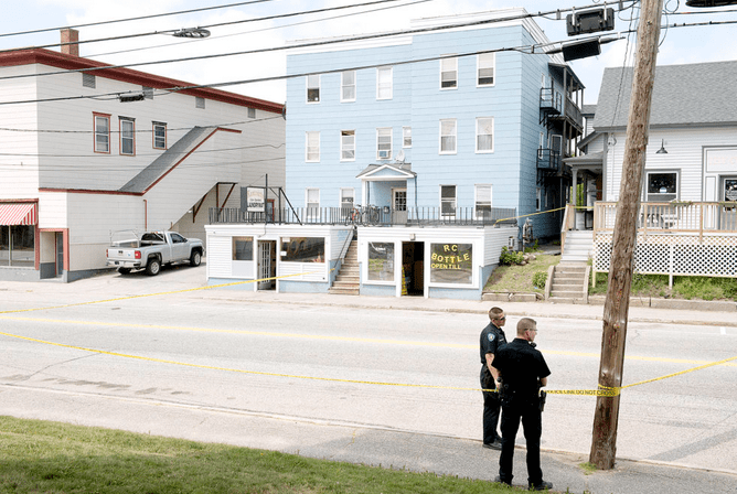 Lewiston police officers closed Sabattus Street, between Oak and College streets, while investigating a fatal stabbing outside Rancourt's Laundromat on Sunday morning.
