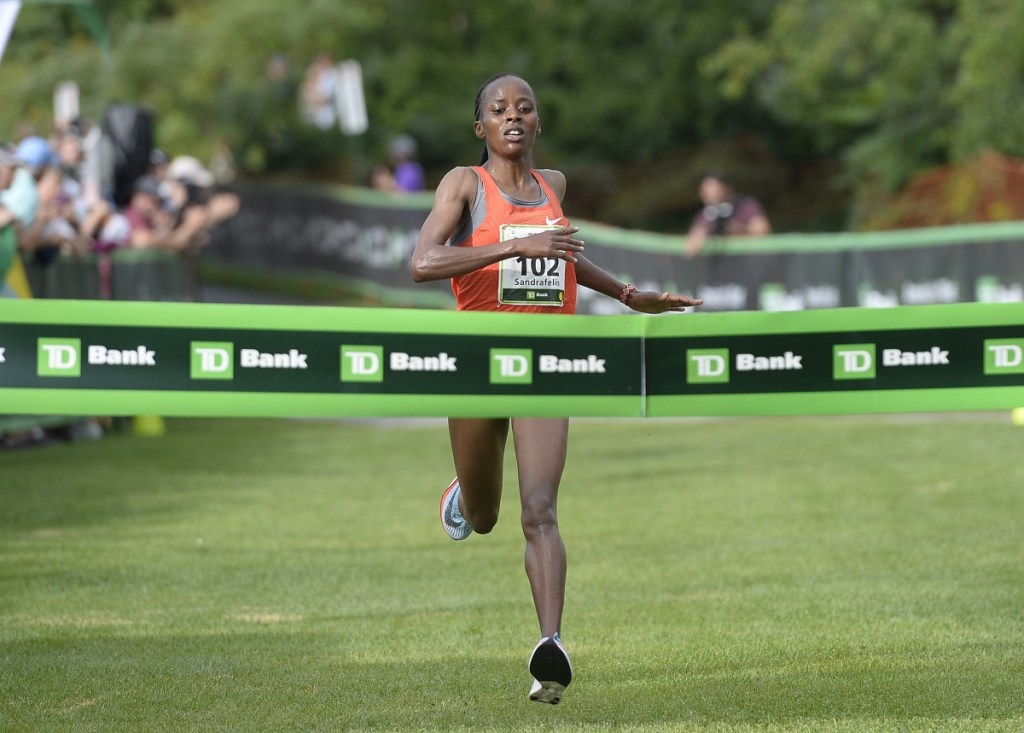 Sandrafelis Chebet Tuei of Kenya approaches the finish line to win the Beach to Beacon road race Saturday.