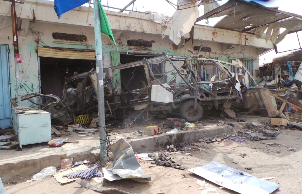 Wreckage of a bus remains at the site of an airstrike in Saana, Yemen, on Friday. Yemen's Shiite rebels are backing a U.N. call for an investigation into a Saudi-led coalition airstrike.