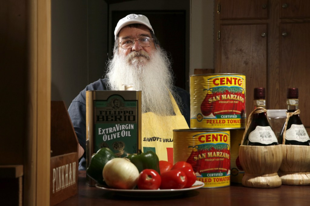 """Steve DeSanctis, surrounded by some of the ingredients for Dynamite sandwiches. """"This is not fast-food Italian. My sauce cooks for at least six-and-a-half hours,"""" says DeSanctis, whose grandfather is credited with serving the first Dynamites in Madison."""