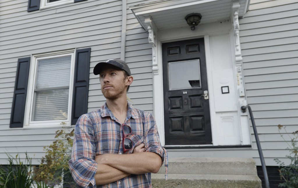William Hessian stands Thursday outside the Frederic Street building in Portland where he used to rent an apartment before it was listed on Airbnb. The city is considering revisiting rules for short-term rentals, giving its housing crunch and skyrocketing year-round rents.