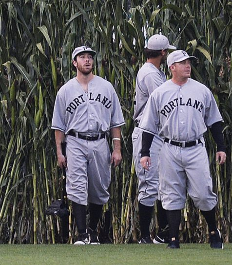 Portland Sea Dogs enter Hadlock Field through cornstalks while wearing throwback uniforms as part of their annual Field of Dreams game Wednesday. It was the next-to-last home game of the season for the Sea Dogs, who won 10-9.