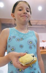 MYA CLARK, 9, OF FREEPORT, won the Freeport Community Library whoopie pie-making contest for the children's category with her blond blueberry entry. She was up against three other young bakers. DARCIE MOORE / THE TIMES RECORD