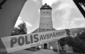 A POLICE CORDON near the scene of a robbery at the Strangnas Cathedral, in Strangnas, Sweden. Police say thieves have stolen priceless treasures from the Swedish royal regalia, including a jeweled crown, from a cathedral where they were on display, before speeding off by motorboat. PONTUS STENBERG/TT NEWS AGENCY VIA AP