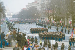 MILITARY UNITS participate in the inaugural parade from the Capitol to the White House in Washington in this January 2017 file photo. A U.S. official says the 2018 Veterans Day military parade ordered up by President Donald Trump would cost about $92 million — more than three times the maximum initial estimate. AP PHOTO / CLIFF OWEN