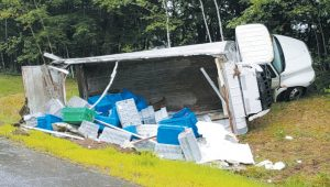 A BOX TRUCK CARRYING LOBSTER rolled over along Route 1 northbound in Brunswick just beyond Cook's Corner on Wednesday. The driver suffered minor injuries and was taken to Mid Coast Hospital. BRUNSWICK POLICE DEPARTMENT PHOTO