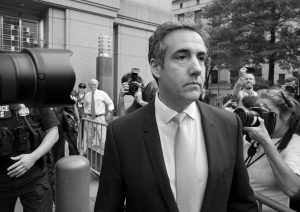 MICHAEL COHEN, former personal lawyer to President Donald Trump, leaves federal court after reaching a plea agreement in New York on Tuesday. AP PHOTO / CRAIG RUTTLE