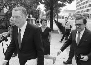 U.S. TRADE REPRESENTATIVE Robert Lighthizer, left, and Mexican Secretary of Economy Idelfonso Guajardo, right, walk to the White House on Monday. AP PHOTO / LUIS ALONSO LUGO