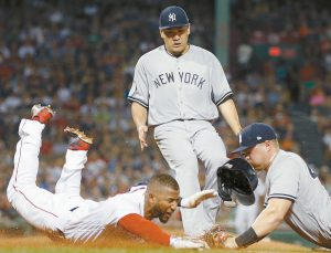 BOSTON RED SOX Eduardo Nunez, left, beats the tag from New York Yankees' Luke Voit, right, on a single as Masahiro Tanaka backs up the play during the second inning in Boston on Sunday. The Red Sox won 5-4, completing the four-game sweep. THE ASSOCIATED PRESS