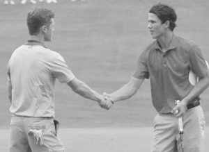 RYAN COLLINS, right, shakes hands with Mitchell Tarrio after Collins won the Maine Junior Amateur boys 16-18 flight at Brunswick Golf Club on Wednesday. Collins rallied from a sixstroke deficit to force an extra hole. Collins made par for the victory. Both Tarrio and Collins finished at even par 144. ERIC MAXIM / THE TIMES RECORD