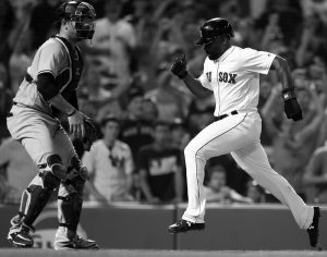 BOSTON RED SOX Jackie Bradley Jr., right, scores in front of New York Yankees' Austin Romine after a throwing error by Miguel Andujar during the ninth inning of a baseball game in Boston. THE ASSOCIATED PRESS