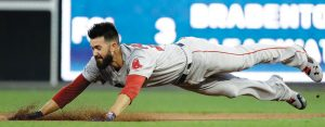 BOSTON RED SOX starting pitcher Rick Porcello dives into second base after hitting a double off Philadelphia Phillies starting pitcher Nick Pivetta during the third inning of a baseball game on Tuesday in Philadelphia. The Red Sox won, 2-1. THE ASSOCIATED PRESS