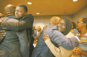 ODELL EDWARDS AND CHARMAINE EDWARDS, parents of Jordan Edwards, react to a guilty of murder verdict during a trial of fired Balch Springs police officer Roy Oliver, who was charged with the murder of 15-year-old Jordan Edwards, at the Frank Crowley Courts Building in Dallas on Tuesday. ROSE BACA / THE DALLAS MORNING NEWS VIA AP