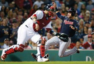 CLEVELAND INDIANS baserunner Yan Gomes, right, scores behind Boston catcher Sandy Leon on a single by Michael Brantley during the sixth inning of a baseball game in Boston on Tuesday. The Indians won, 6-3. THE ASSOCIATED PRESS