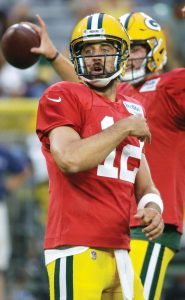 GREEN BAY PACKERS quarterback Aaron Rodgers reacts to one of his passes in a quarterbacks drill during a recent practice. Rodgers expects to play when the Packers host the Pittsburgh Steelers on Thursday in an NFL preseason game at Lambeau Field. THE ASSOCIATED PRESS