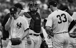 NEW YORK YANKEES starting pitcher Sonny Gray, left, leaves the mound as he is relieved during the third inning of a baseball game against the Baltimore Orioles on Wednesday in New York. THE ASSOCIATED PRESS