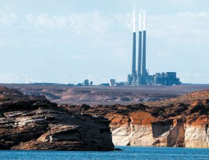 THIS PHOTO shows the main plant facility at the Navajo Generating Station, northeast of Grand Canyon National Park as seen from Lake Powell in Page, Arizona. A new study concludes visitors may be steering clear of some U.S. national parks or cutting their visits short because of pollution. THE ASSOCIATED PRESS