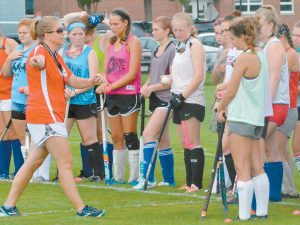 THE MT. ARARAT HIGH SCHOOL sports teams will be playing at different venues this fall. Pictured on top, clockwise, field hockey coach Krista Chase explains a drill to her players, Wyley Fitzpatrick dribbles a ball, and Travis Nadeau prepares to pass. THE ASSOCIATED PRESS
