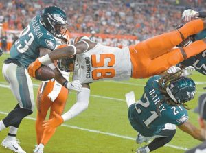 CLEVELAND BROWNS tight end David Njoku (85) is up-ended during the first half of an NFL preseason football game against the Philadelphia Eagles on Thursday in Cleveland. THE ASSOCIATED PRESS