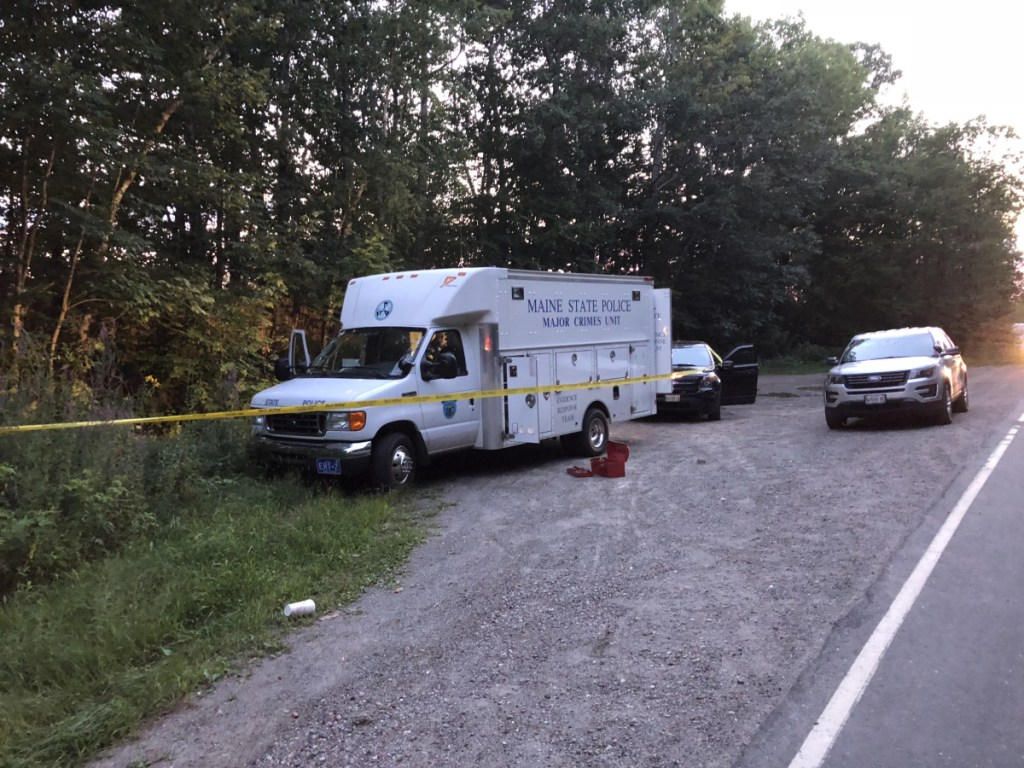 A state police major crimes van stands parked Thursday at the side of Weeks Mills Road in Augusta, near where a body was found Thursday afternoon.
