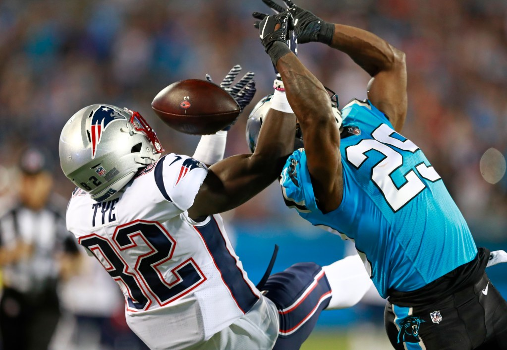 Carolina's Mike Adams  knocks a pass away from New England's Will Tye (in the first half Friday night at Charlotte, N.C.
