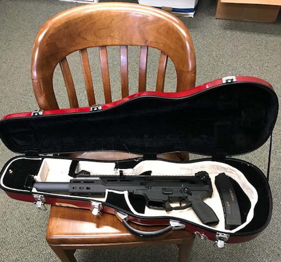 Police say they seized this gun, stored in a violin case, from a man charged with terrorizing in Bowdoinham.