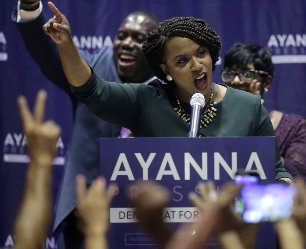 """Boston City Councilor Ayanna Pressley celebrates her victory Tuesday over U.S. Rep. Michael Capuano. """"With our rights under assault, with our freedoms under siege, it isn't good enough to see Democrats back in power, but it matters who those Democrats are,"""" Pressley said."""