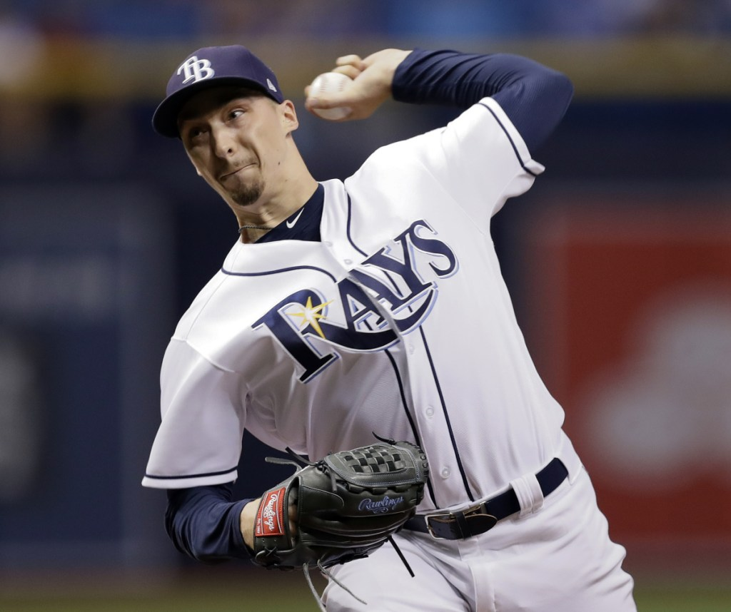 Tampa Bay's Blake Snell beat the Baltimore Orioles Friday night for his 18th victory of the season. Snell matched Cleveland's Corey Kluber for the major league lead in wins.