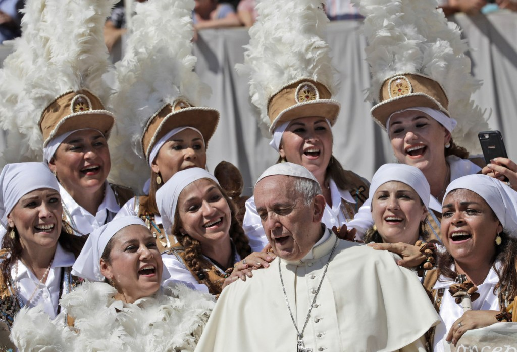 Pope Francis sings with a group of Mexican pilgrims at the end of his weekly general audience in St. Peter's Square at the Vatican on Wednesday. On Saturday he told newly ordained bishops to reject abuse but did not address the most recent allegations against the Catholic Church.