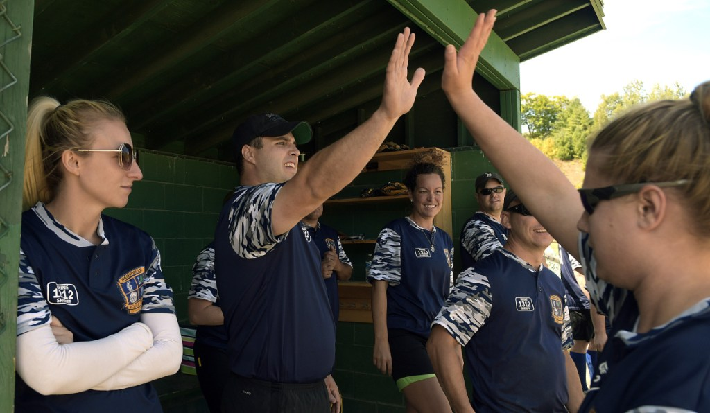 The Waterville Police Department softball team celebrates a run Sunday during the Fraternal Order of Police tournament in Sidney. The fourth annual tournament was held in honor of Cole's father, Somerset Deputy Cpl. Eugene Cole, who lost his life in the line of duty April 25 in Norridgewock.