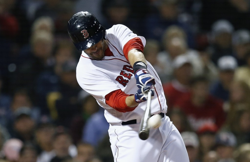 J.D. Martinez connects for a three-run homer in the fifth inning Sunday night during Boston's 6-5 win over the Astros. (Associated Press/Michael Dwyer)