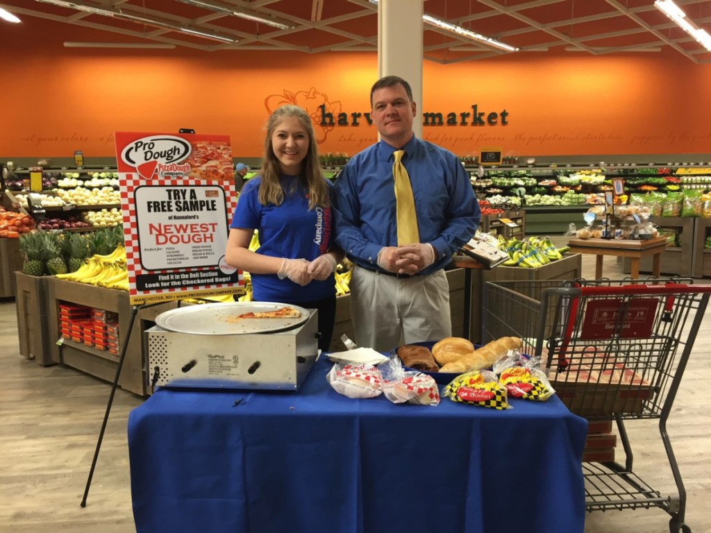 Tim Gyorda and his daughter Emily offer samples of Pro Dough at Hannaford. Gyorda is the only out-of-state, MOFGA-certified pizza dough maker.