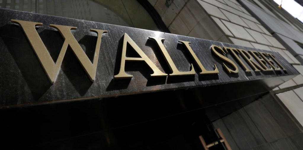 FILE- This April 5, 2018, file photo shows a building's address on Wall Street in New York. The U.S. stock market opens at 9:30 a.m. EDT on Thursday, Sept. 6. (Associated Press/Richard Drew, File)
