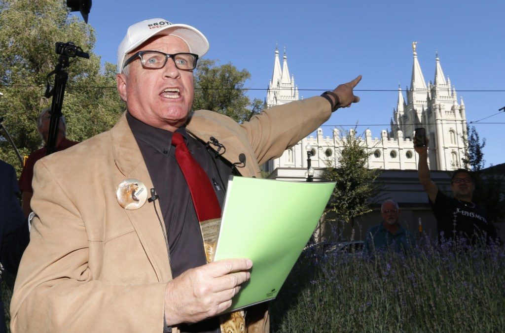 """Sam Young speaks in Salt Lake City on Sunday about his excommunication from The Church of Jesus Christ of Latter-day Saints. """"The whistleblower has been kicked out,"""" he said. """"But ... for our children's sake, this whistleblower is not going to stop roaring."""""""
