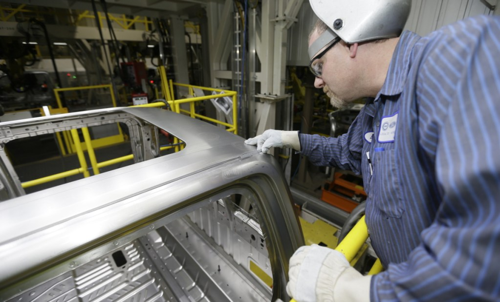 In a photo from Nov. 6, 2014, Ron Hudgin measures the roof line of the F-150 truck at the Rouge Truck Plant in Dearborn, Mich.
